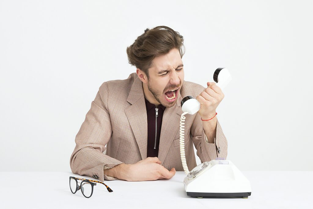 Man shouting at phone, Have your say on the Mutual Respect Policy